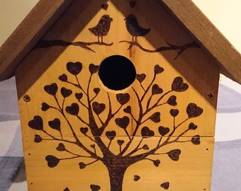 Garden bird house with one off pyrography design