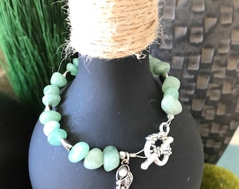 light green beaded bracelet.  Has a heart toggle clasp and seashell charm  7 1-2""