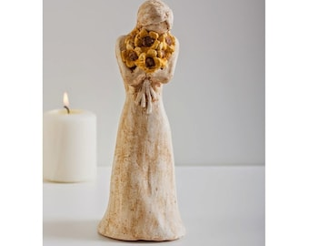 Girl Holding Yellow Flowers Sculpture