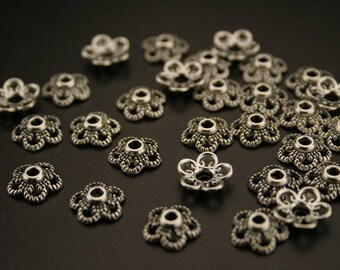 100 bead caps in antique silver. (ref:3059).