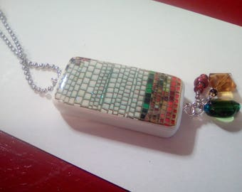 Faux mosaic two sided pendant made from a domino. Comes with three glass dangles.