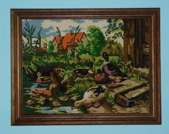 Picture of a rural landscape embroidered by hand.
