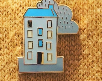 Tenement pin badge