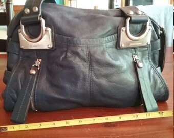 Beautiful navy colored leather handbag