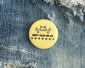 don't grab on me, pussy button, feminist pin, feminist button, feminist badge