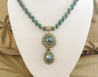 Norrie Necklace: Teal and sage green beaded rope necklace of Swarovski pearls and crystals, with 2 inch Swarovski bezelled sage pendant.
