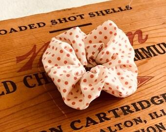 Pink polka dotted scrunchie