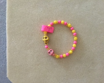 "7"" Large Pink & Yellow Skulls Bracelet."