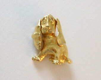 Monet puppy dog pin brooch in golden tone.  Vintage costume jewelry.