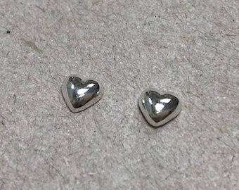 Tiny solid sterling silver heart stud
