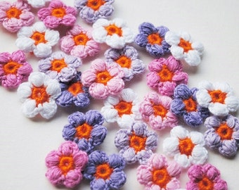 Crochet flower appliques in different shades of pink / Purple and white. Crochet supplies for your scrapbooking, cards and other crafts.