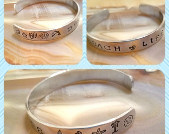 Beach Life hand stamped aluminum cuff bracelet chock full of shells seahorses dolphins flip flops and so much more