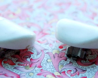 A pair of minimalist originla vintage clip-ons
