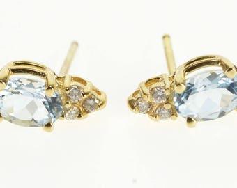 14k Blue Topaz Oval Diamond Accented Post Back Earrings Gold