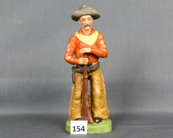 Old west Cowboy figurine Brown hair Dark eyes Hat, Bullets and six shooter Fringe chaps Rife Mustache Mountain man Made in Taiwan