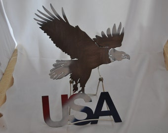 US02 Bald Eagle USA metal sign. Flying eagle carrying the letters U.S.A
