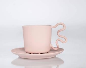 Coretto espresso cup in delicate pink, whimsical ceramic mug designed for good coffee
