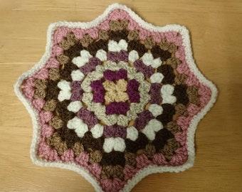 Hand crocheted star doily