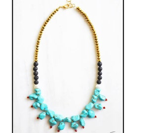 CTC013 - Elegant statement necklace with turquoise howlite, white pearls, black lava stones, red and gold crystals