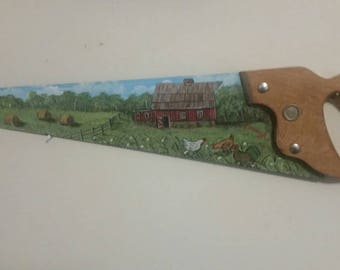 Painting on a handsaw of neat old red barn, chickens, hay Bales in the field in a Pastorial scene.