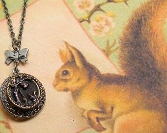 Squirrel, 1800s BUTTON necklace, Unusual Victorian animal with shotgun, on silver chain. Antique button jewellery.