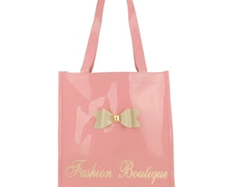Assorted colours of handbags and totes - high gloss pu with pretty bow detail.