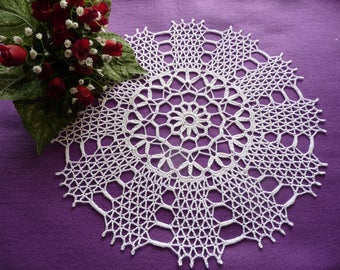 Handmade white cotton lace doily.