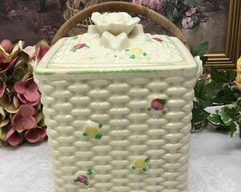 Mid century biscuit jar with bamboo handles.
