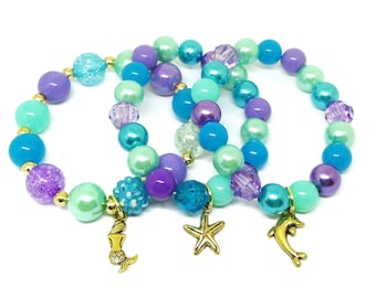 Gold Under the sea Mermaid bracelets party favors in organza bags with special birthday girl bracelet!