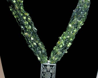 Crocheted necklace with flower pendant in lime green