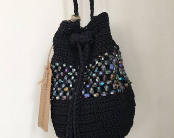 Black crochet crossbody drawstring purse with iridescent beads