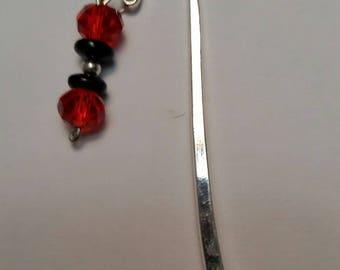 Shepherd's hook bookmark;  Crystal bookmark;  Red and black crystal