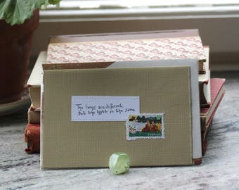 The lamps are different but, the light is the same Card with handwritten quote and postal stamp