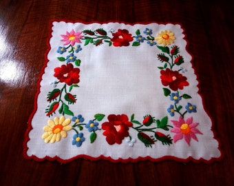 """Hand made 10"""" floral doily, embroidered table topper."""