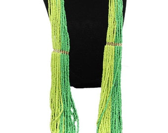 Multi-strand green bead necklace