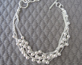 Versatile Six Strands Petite Silver Chain and Moving Silver Beads Bracelet