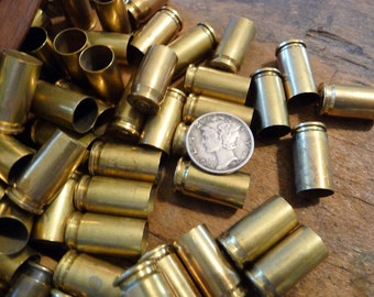 BULLETS - 12 brass shells, bullet casings, spent shells, small bullet shells