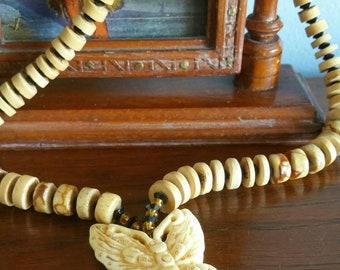 Vintage boho carved butterfly necklace.