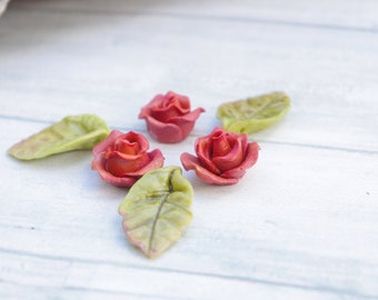 3 roses and 3 leaves, molded of cold porcelain