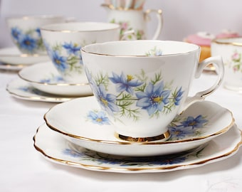 Pretty Love in the Mist / corn flower tea set: Royal Vale and Colclough mismatched tea cup, saucer and tea plate make up this lovely set.