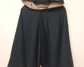 Reversible water repellent fashion poncho in taupe and black!