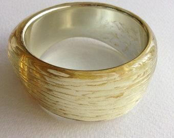 Bangle - gold ridged texture lucite plastic retro style bangle