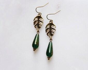 monstera deliciosa. a pair of boho tropical botanical leaf beaded teardrop earrings.