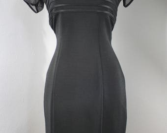 1990s Black Stretch Bodycon Dress by Catchet.  Cap sleeves, fitted, mini skirt. Size Large or 10.