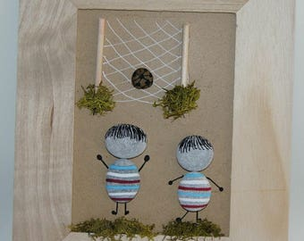 Pebbles and natural wooden frame