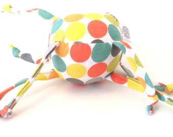 Colorful dots on unique baby toy with knotted strings - Zadymini