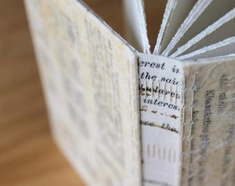Long Stitch Notebook with Antique Vellum Document Spine, Decorative Stitching, and Mixed Paper Pages