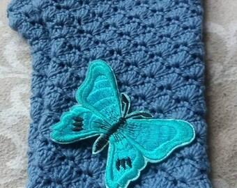 Denim blue crochet fingerless gloves, with teal butterfly.
