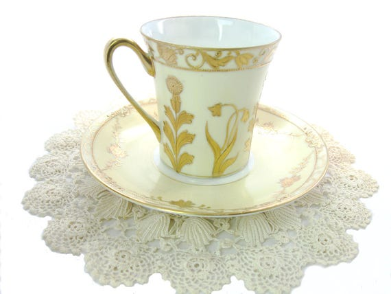 Antique Hand Painted Nippon Demitasse Tea Cup Saucer in Yellow w/ Gold Floral Decoration, 1910's.