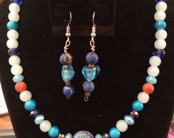 necklace and earring set with blues and oranges.    heart detail